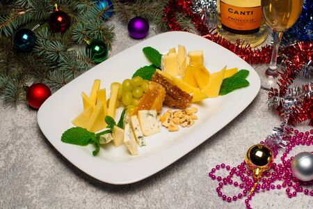 Christmas cheese cut with honey on a plate
