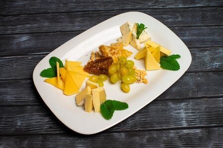 Christmas cheese cut with honey on a plate. Banco de Imagens