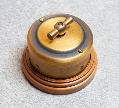 old-style power strip, light switch, scuffs and scratches