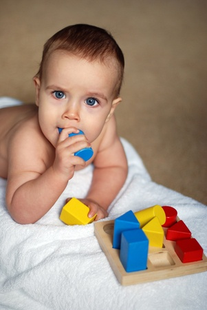 baby playing colour  bricks photo