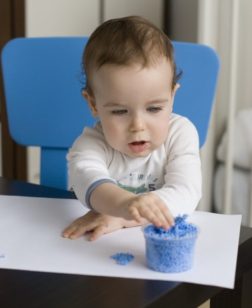baby play with blue plasticine Stock Photo - 9100934