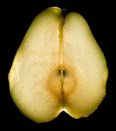 juicy luminous pear on black background