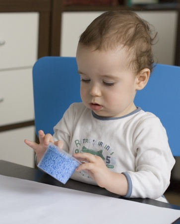 baby play with blue plasticine Stock Photo - 9100933