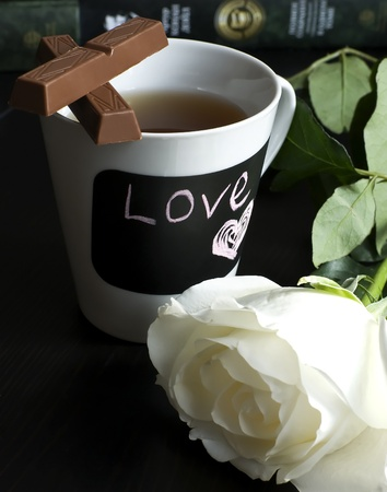 cup of tea with chocolate and rose Stock Photo
