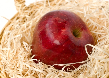 Close up view of red apple on straw Stock Photo
