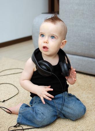 Portrait of serious baby in the earphones