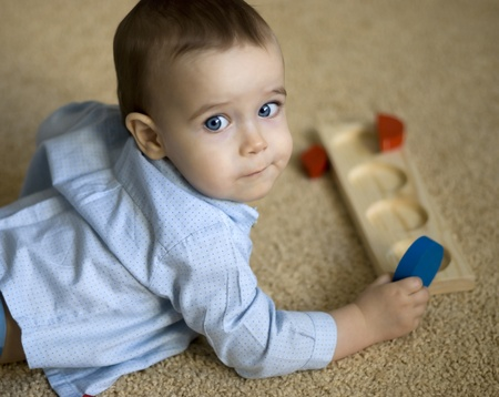 Portrait of  boy playing with intellectual toy