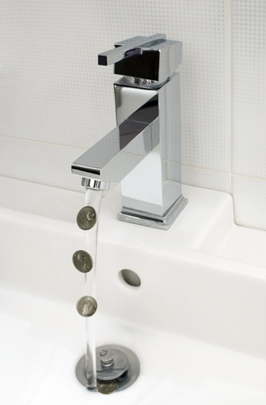 Flowing tap water and coins