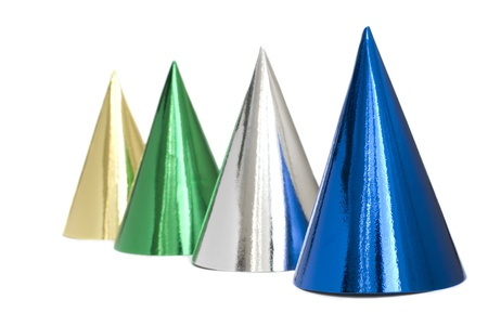 headwear: Colored caps standing in a row, isolated Stock Photo
