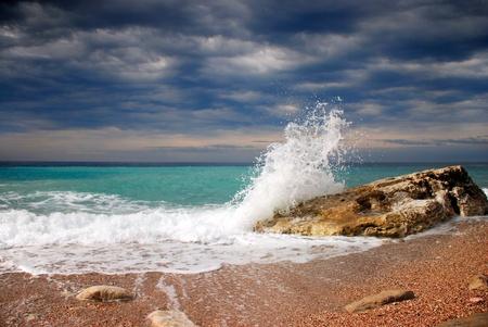 Wave crash on the stone photo