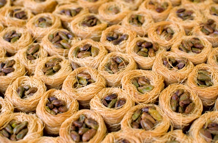 Close of many oriental sweets with pistache photo