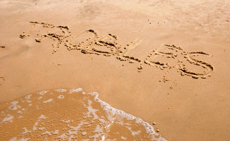 inscription dans le sable.