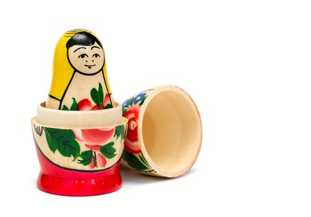Russian wooden toy in the form of a painted doll, inside which are similar to her dolls smaller