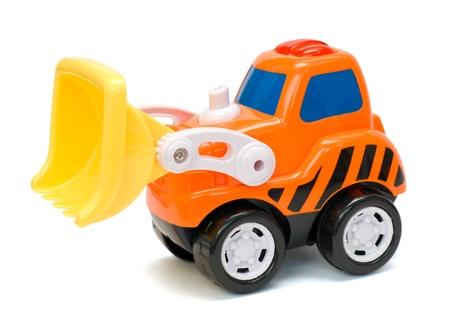 Excavatrice jouet orange dr?le, isol? Banque d'images