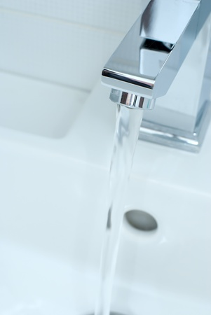 Closeup of modern bathroom tap in blue photo