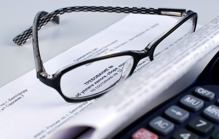tax document with  calculator and glasses