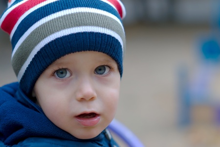 Portrait of handsome little boy on playground Stock Photo
