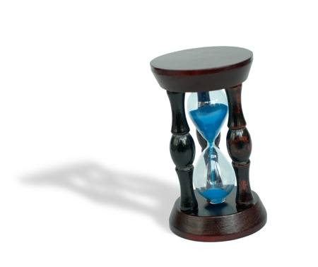 Hourglass with blue sand on white background Stock Photo - 11111911