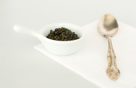 Bon appetit - caviar and silver spoon photo