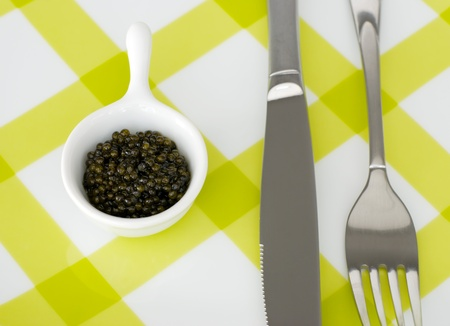 Bon appetit - caviar, fork and knife photo