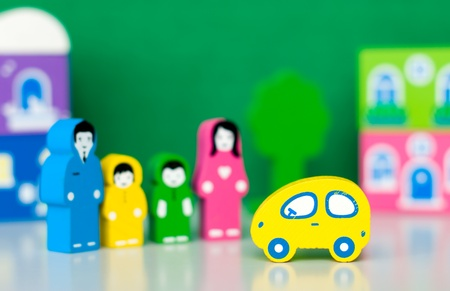 Toy car and toy family Stock Photo