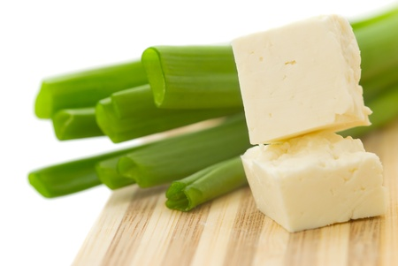 cubed: Cubed cheese with green onion on a kitchen counter
