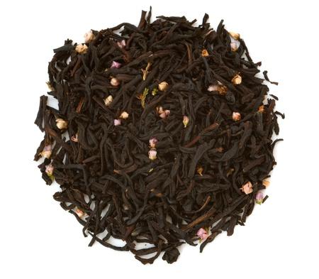 black tea: Black tea with flowers isolated on white