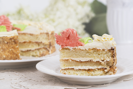 Creamy cake on plate on table on light background, selective focus. Stock Photo