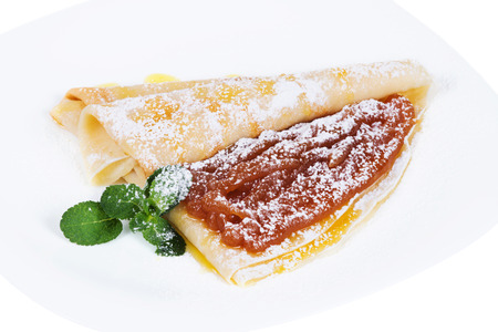 confiture: Pancakes with confiture and mint  on a plate, isolated