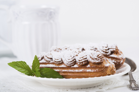 condensed: Eclairs on plate on a table on light background Stock Photo