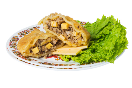 Caucasian pie stuffed with meat  and cheese (cheburek) on plate, isolated