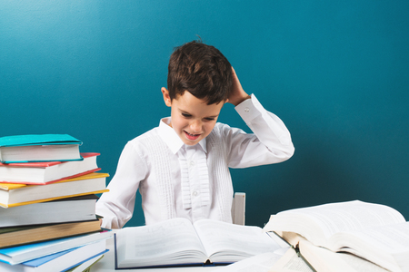 quandary: Student at elementary school thinking about problem solving, blue background