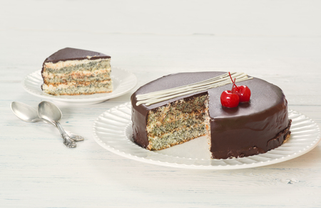 poppy seed: Chocolate-covered poppy seed cake with cherries on plate