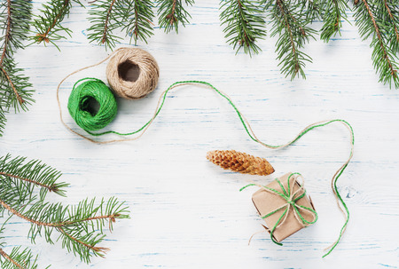 Christmas gift, knitted blanket, pine cones, fir branches, top view Stock Photo