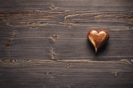 Red Valentines heart on rustic wooden background, copy space