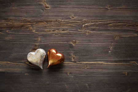 White and red Valentines hearts on rustic driftwood texture background, copy space