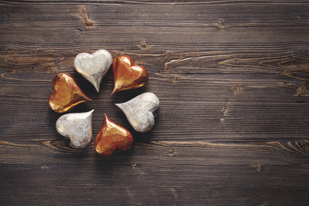 White and red Valentines hearts on rustic wooden background, copy space