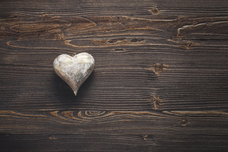 White Valentines heart on rustic wooden background, copy space