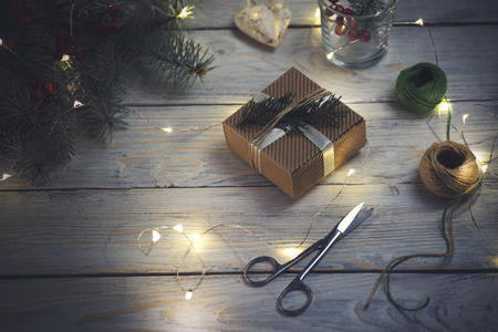 Small beautifully wrapped gift on a wooden background