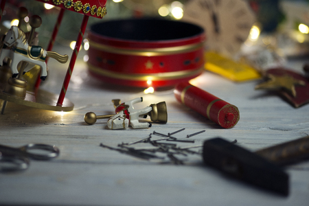 Repairing of carousel toy  on a wooden table Stock Photo