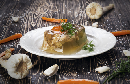 Russian meat jelly on wooden background