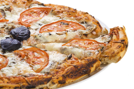 Tasty pizza with sausage, mushrooms and tomato, isolated