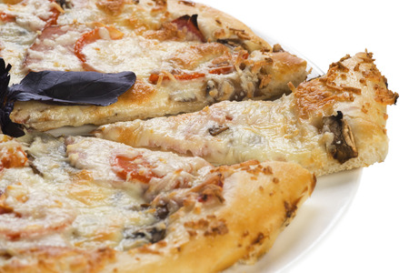 Tasty pizza with ham, mushrooms and tomato, isolated