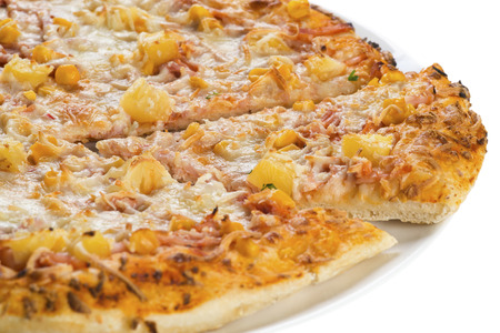 Tasty pizza with pineapple and corn, isolated Standard-Bild
