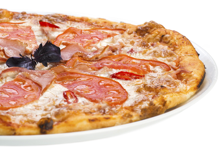 Tasty pizza with ham and tomato, isolated