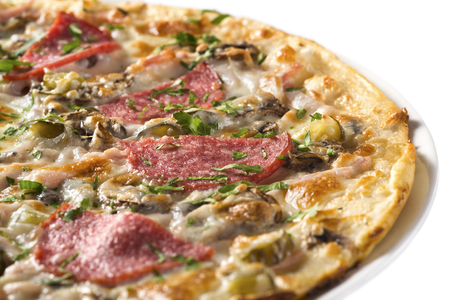 Tasty pizza with sausage, mushrooms and cucumber, isolated