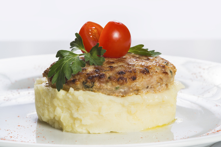 Cutlets with mashed potatoes decorated tomato Standard-Bild