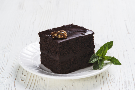 Chocolate cake on plate on the light background Standard-Bild