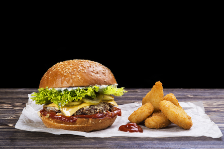 Craft beef burger and french fries on wooden table Standard-Bild