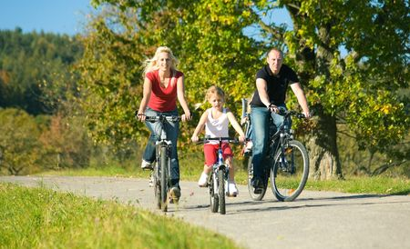 activity: A family with children having a weekend excursion on their bikes